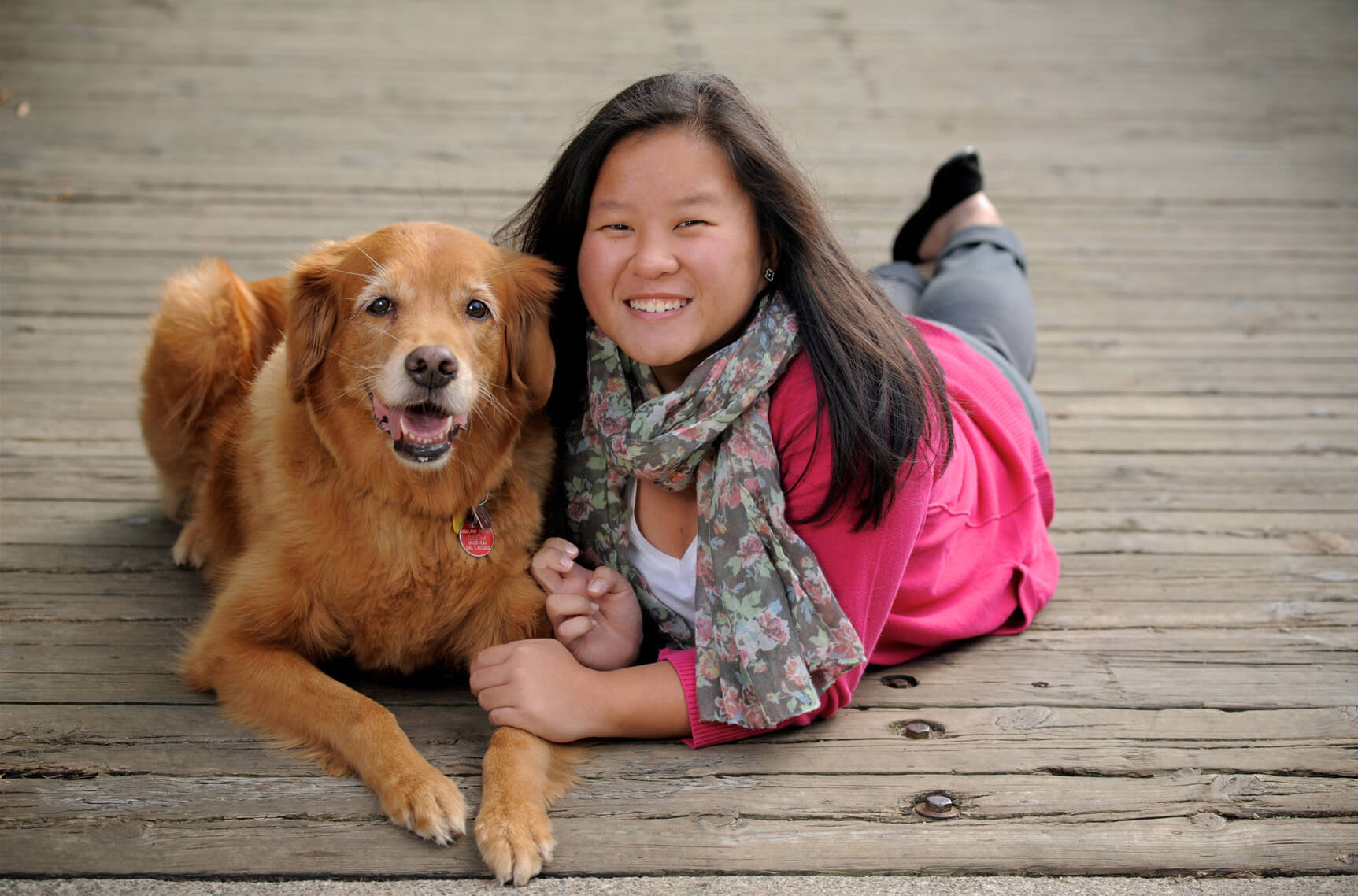 A Troy High senior poses with her dog during her senior photos.