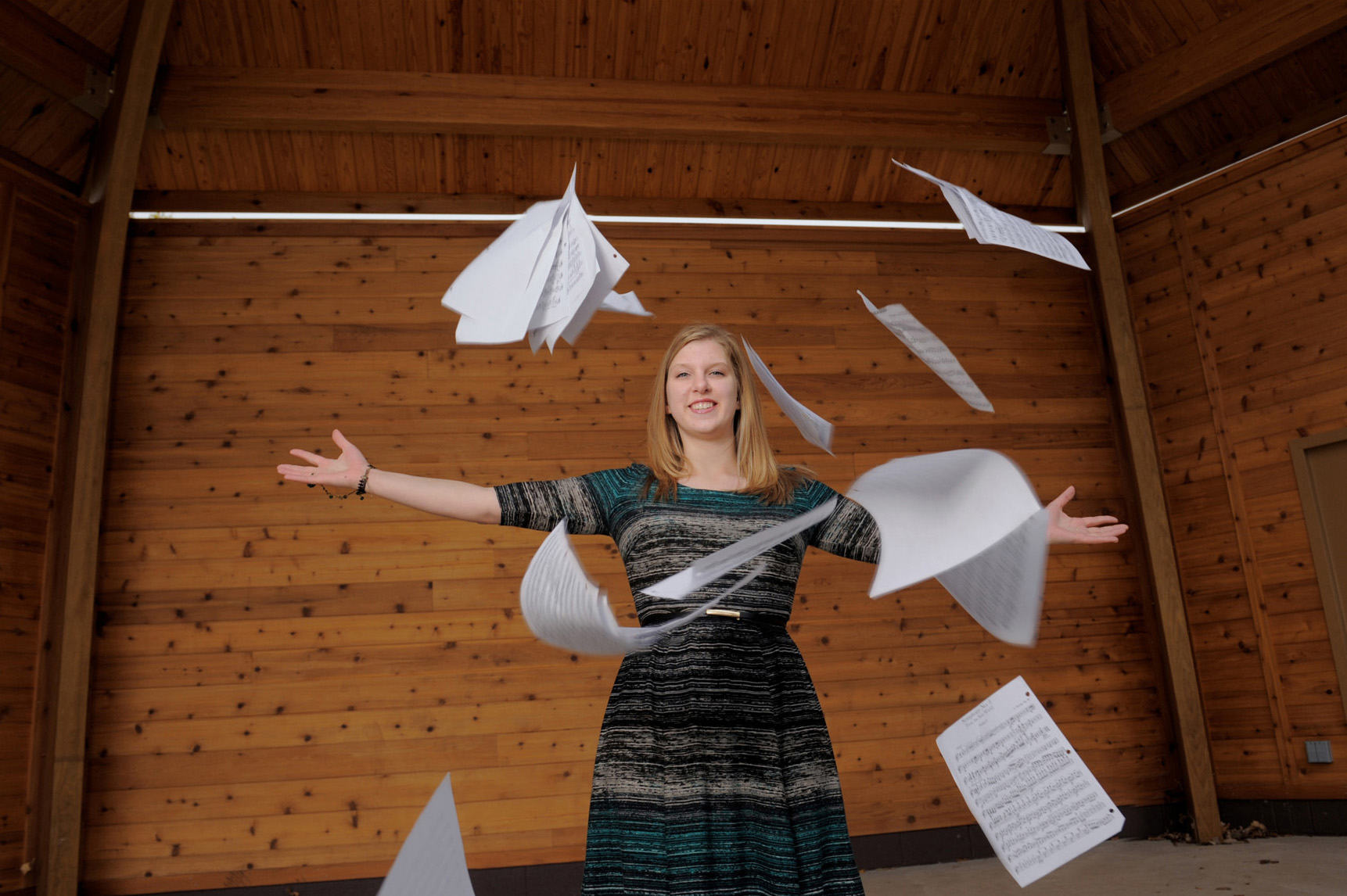 A Lake Orion, Michigan senior throws up her sheet music for a fun and dramatic photo of a musician.