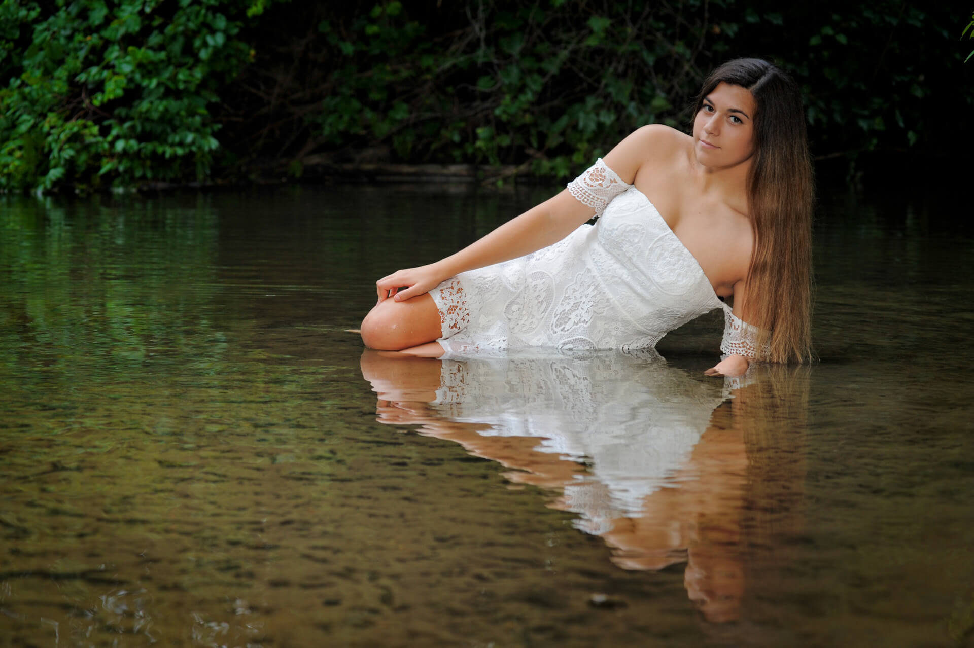 A Troy, Michigan senior plops into a river for this stunning senior photo.