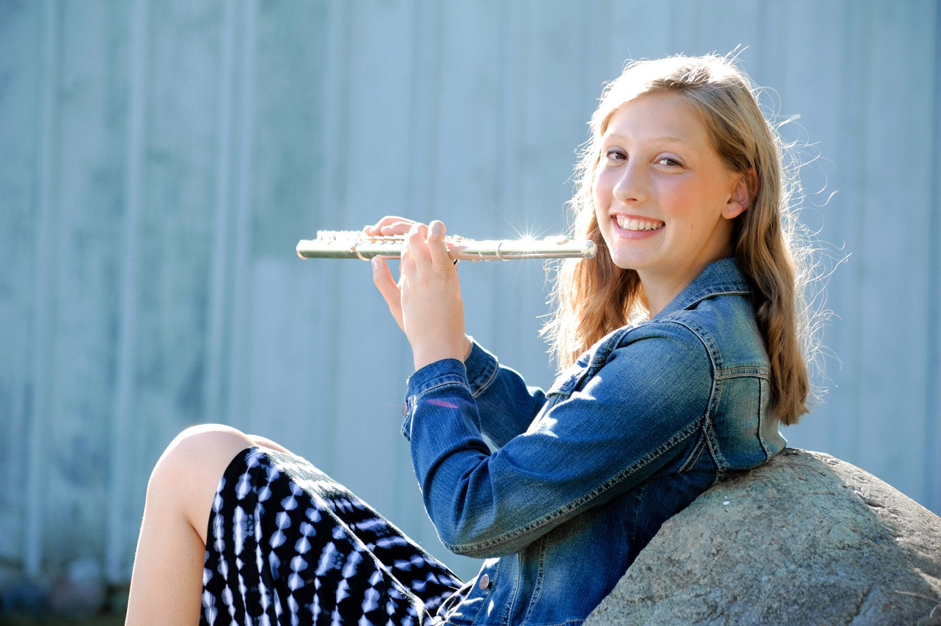 Troy, Michigan band member has her senior  photo of a high school senior posing with her flute for her senior pictures in Troy, Michigan.