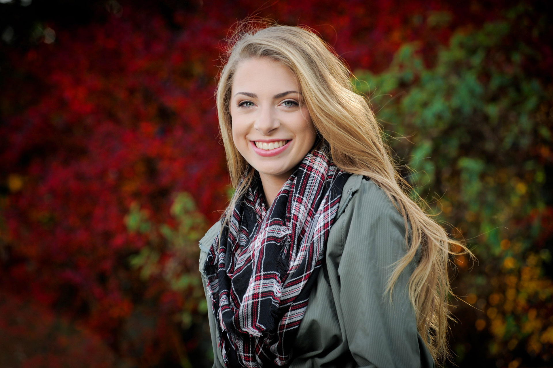 Troy, Michigan senior photographer's photo taken as the high school senior gets her senior pictures in Troy, Michigan during the peak of fall colors