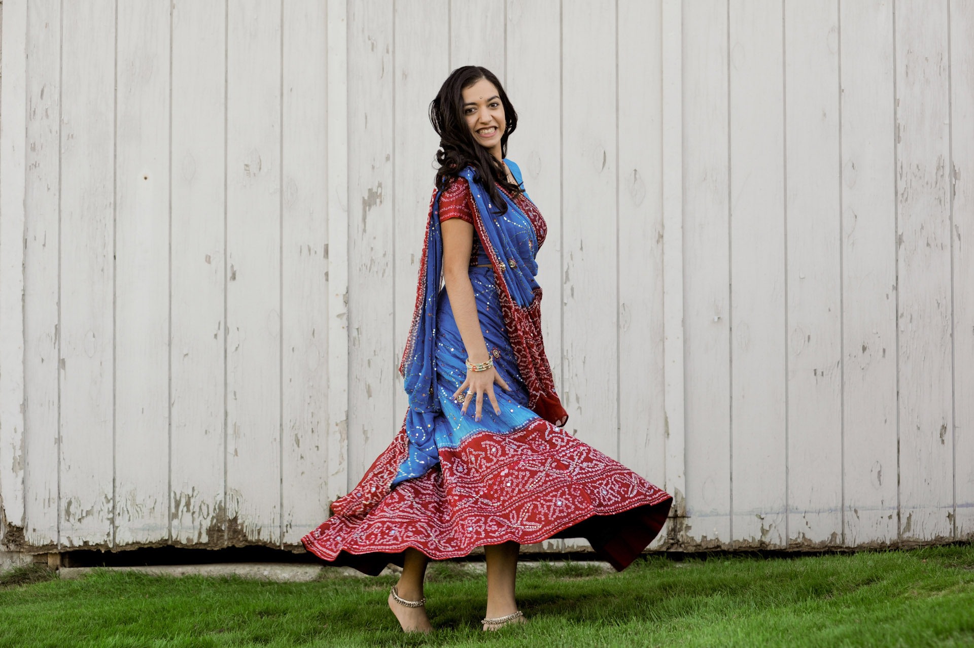 Troy, Michigan senior photographer's photo of a high school senior of her Indian dancing for her senior pictures in Troy, Michigan.
