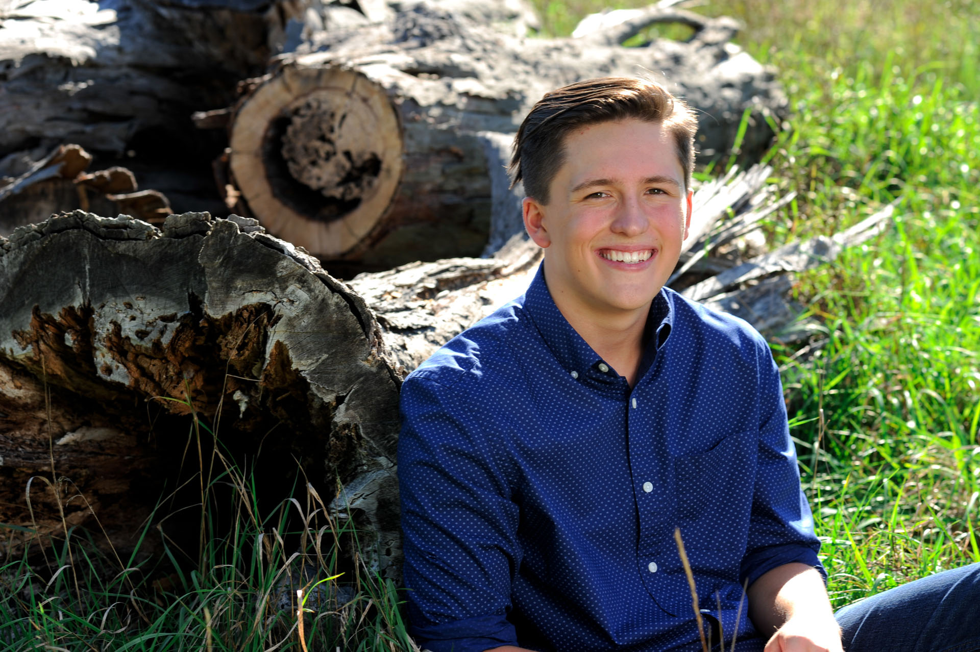 Troy , Michigan senior photographer shows a high school senior standing out in nature during his senior shoot.