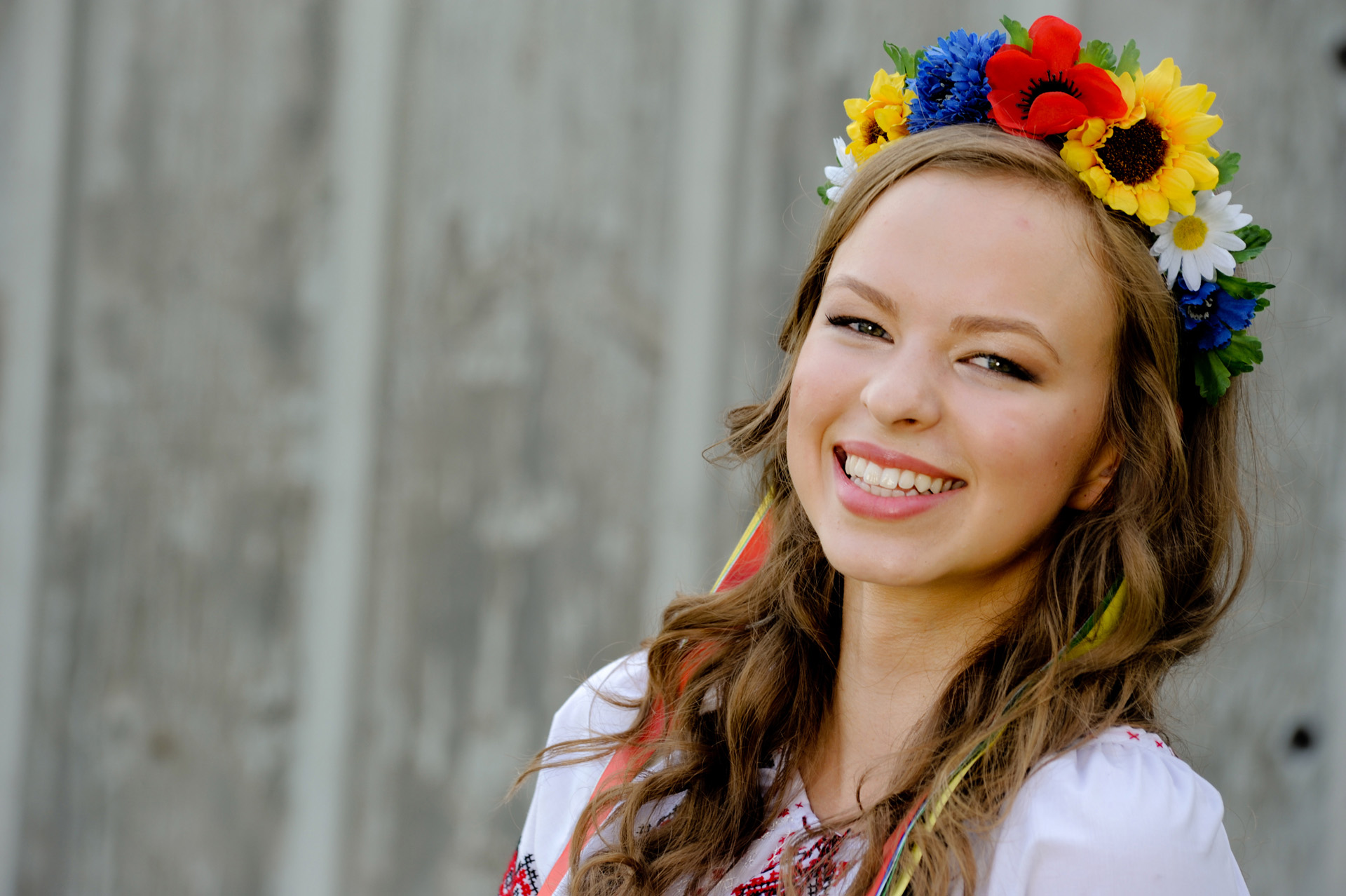 Troy , Michigan senior pictures photo of a high school senior posing in her traditional Russian dance outfit for her senior pictures in Troy, Michigan.