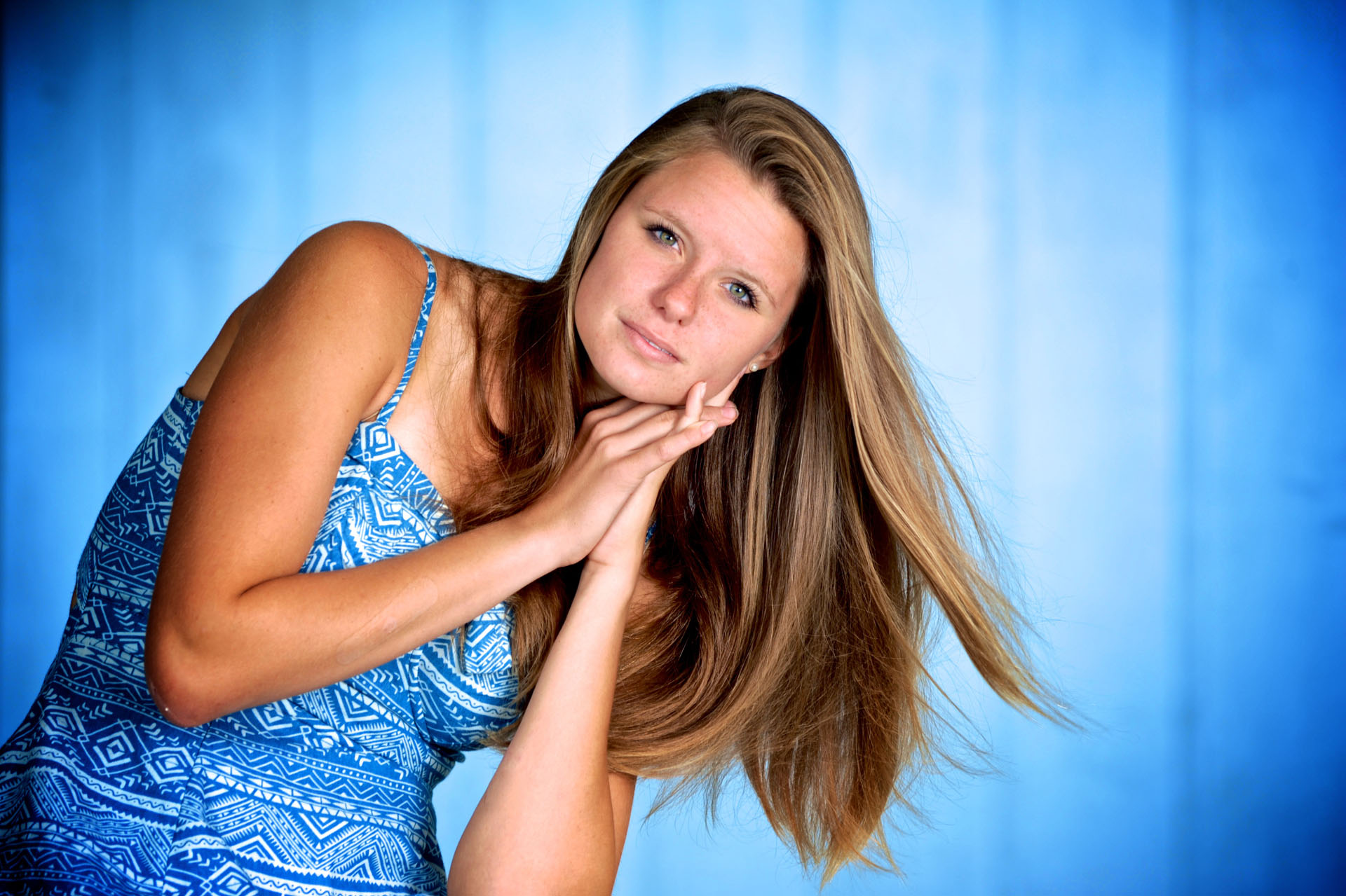 Troy , Michigan senior photographer's portrait of the high school senior posing for their senior pictures in Troy, Michigan.