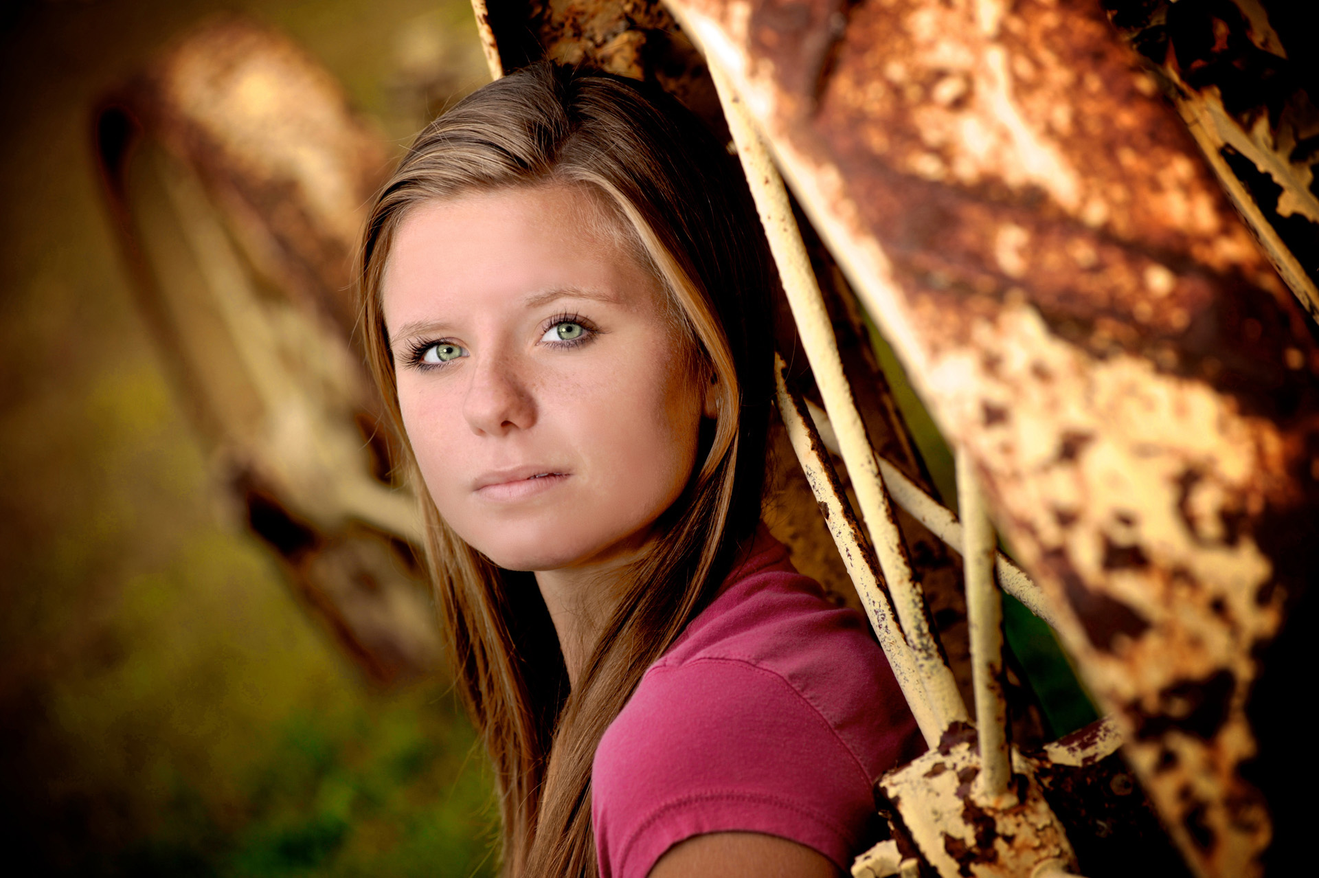 Troy , Michigan senior photographer's photo of a high school senior posing with nearby natural props used on location for their senior pictures in Troy, Michigan..