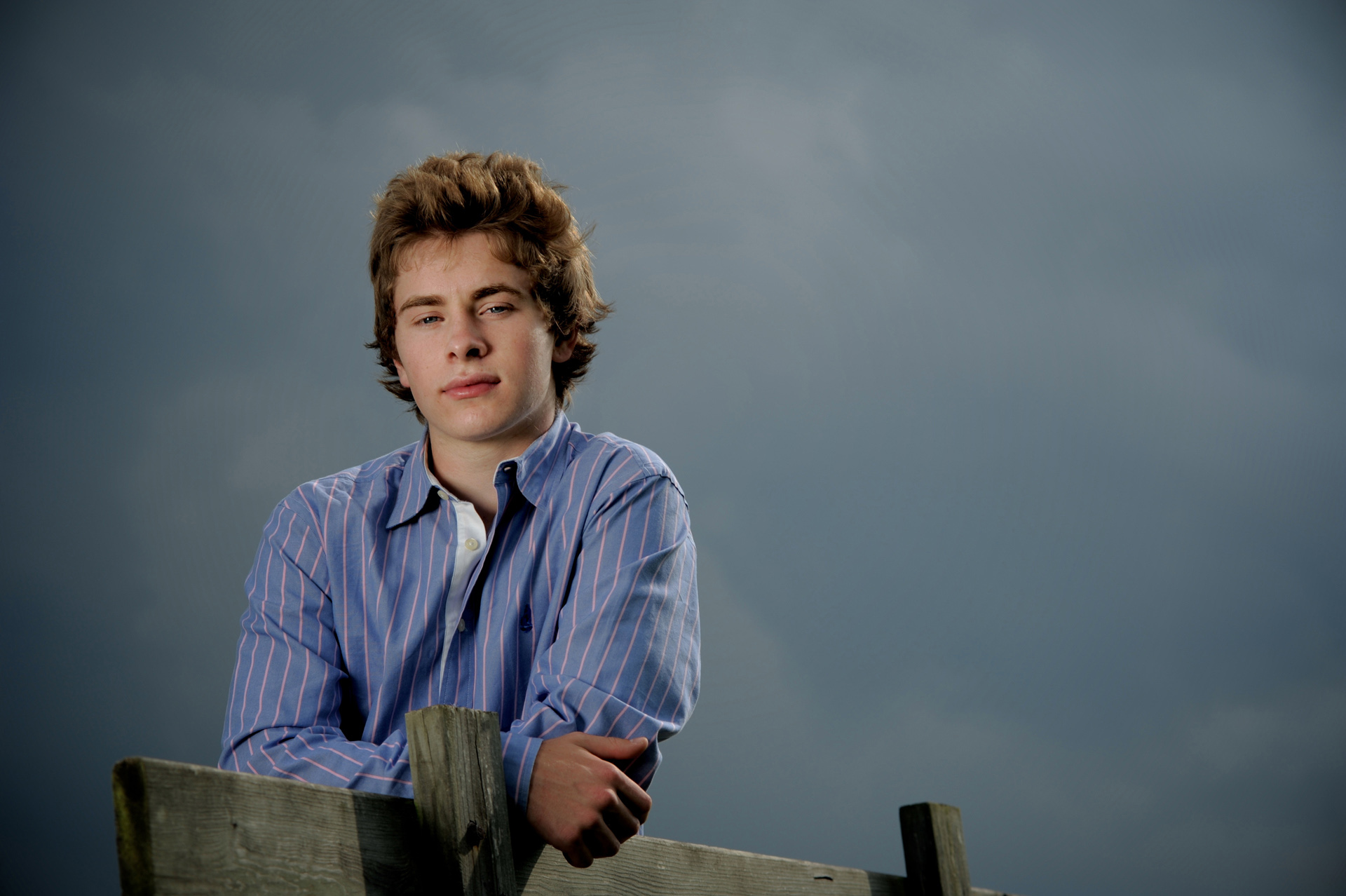 Troy , Michigan senior photographer's photo taken as the high school senior gets his troy-senior-photos taken just before a huge storm.
